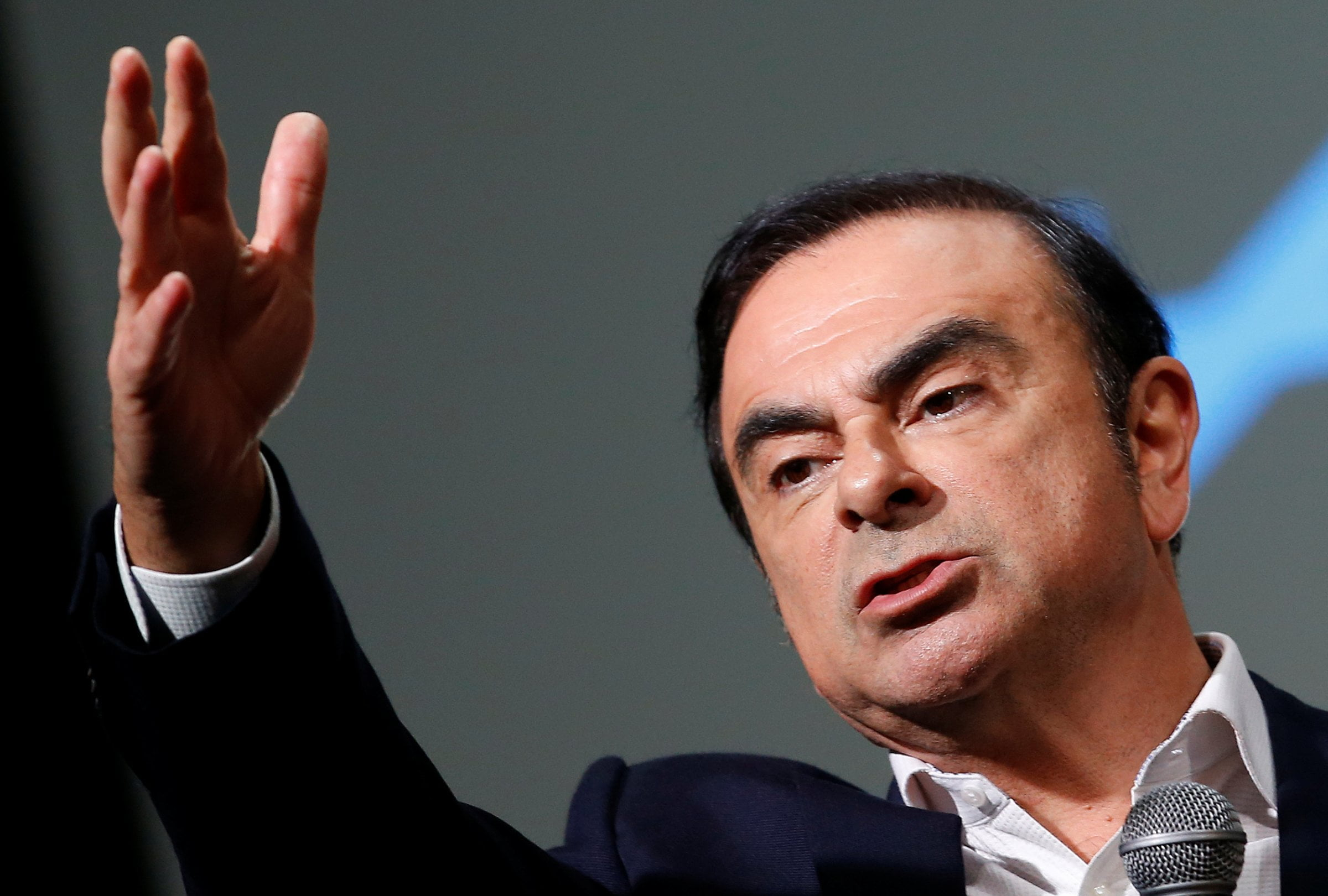 FILE PHOTO - Carlos Ghosn, Chairman and CEO of the Renault-Nissan Alliance, gestures as he speaks during the presentation of the Renault's new Alpine sports concept car