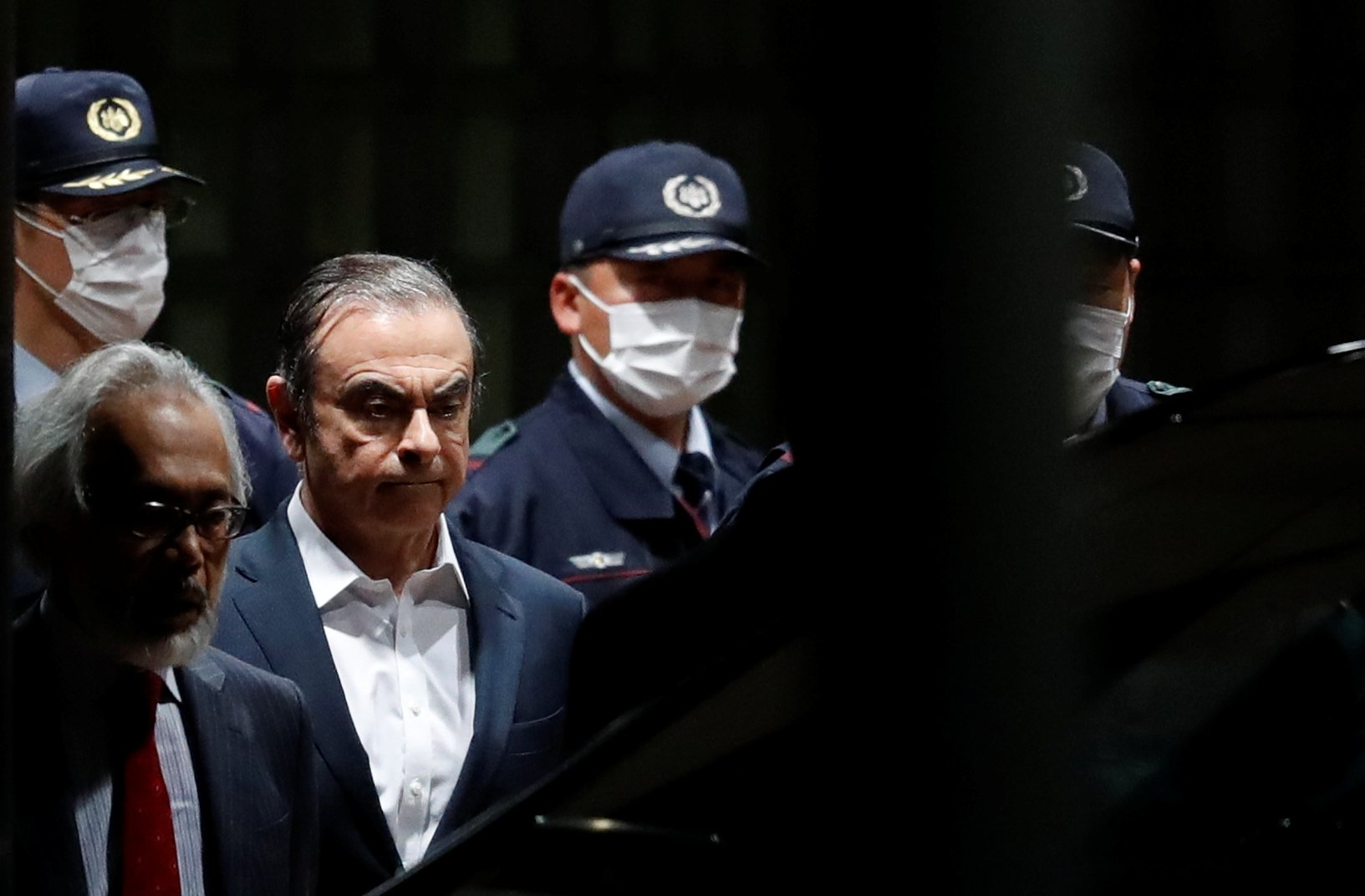 FILE PHOTO: Former Nissan Motor Chariman Carlos Ghosn leaves the Tokyo Detention House in Tokyo, Japan April 25, 2019. REUTERS/Issei Kato