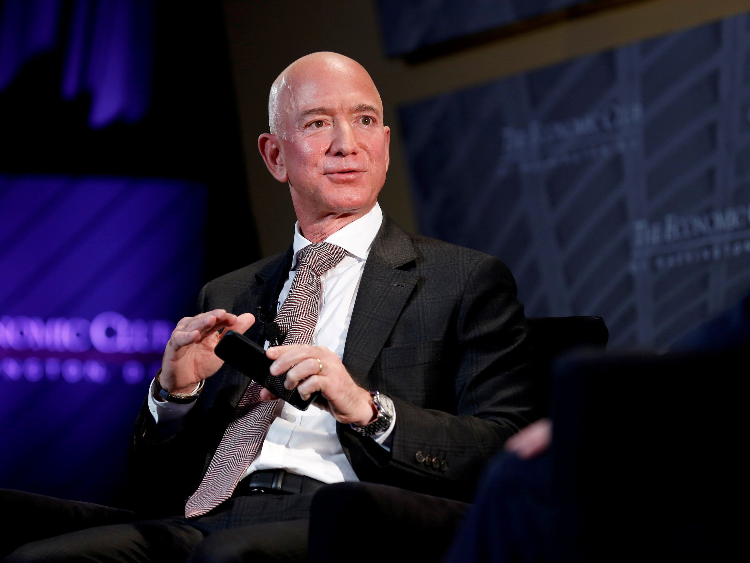 FILE PHOTO: Jeff Bezos, president and CEO of Amazon and owner of The Washington Post, speaks at the Economic Club of Washington DC's