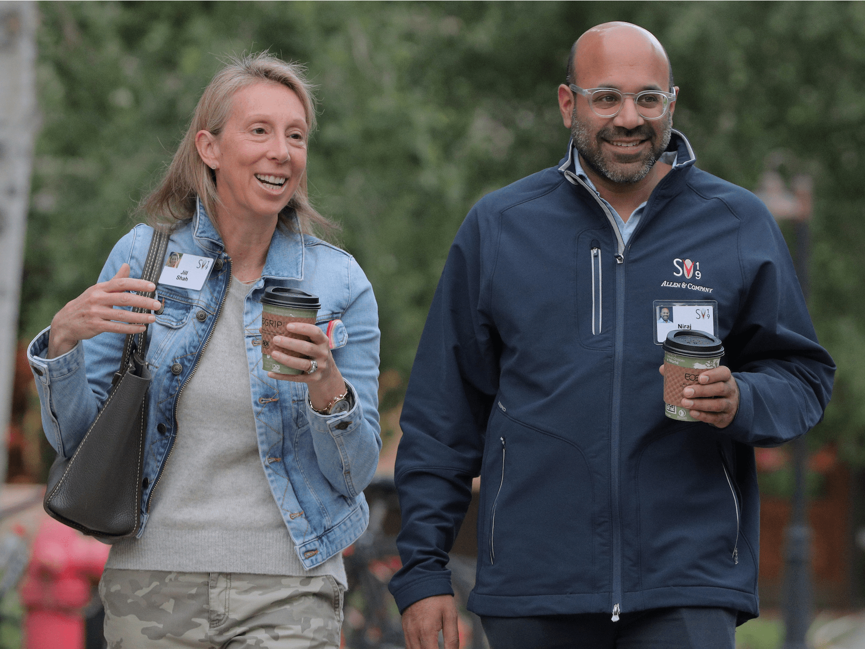 Jill Shah, founder and CEO of Jill's list, walks with her husband Niraj Shah, co-founder, co-chairman, and CEO of Wayfair, attend the annual Allen and Co. Sun Valley media conference in Sun Valley, Idaho